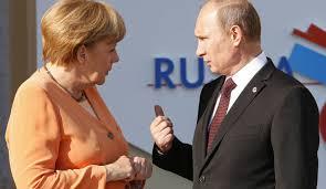 Merkel vrea să continue să discute cu Putin