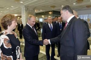 Putin și Poroșenko și-au strâns mâna.