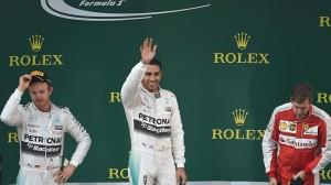 Lewis Hamilton (C) finished ahead of Nico Rosberg (L) and Sebastian Vettel (R