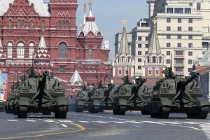 Russian servicemen onboard self-propelled artillery vehicles salute during the Victory Day Parade in Moscow's Red Square