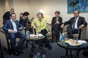 German Chancellor Angela Merkel and French President Francois Hollande attend a meeting with Greek Prime Minister Alexis Tsipras in Riga