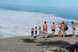stripping naked and urinating on Mount Kinabalu