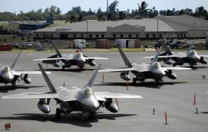 F-22 Raptors sit on the flight line
